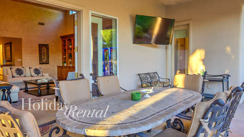 Out door dinning area with a 70 inch T.V for guest use