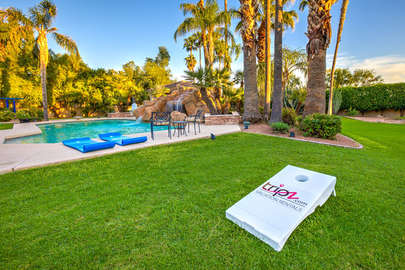 Pool view with also corn holes